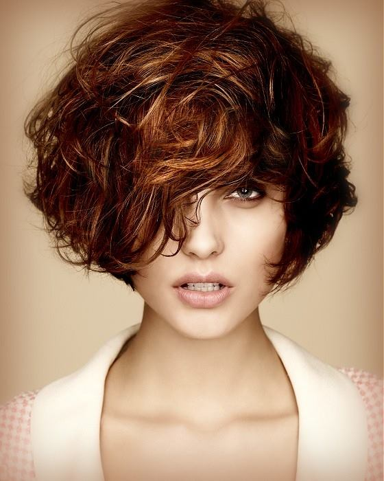Short, curly, brown hairstyle