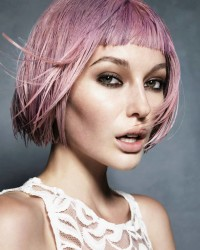 Short, pink haircut with blunt bangs