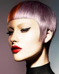 Short, bowl cut hairstyle with violet hair