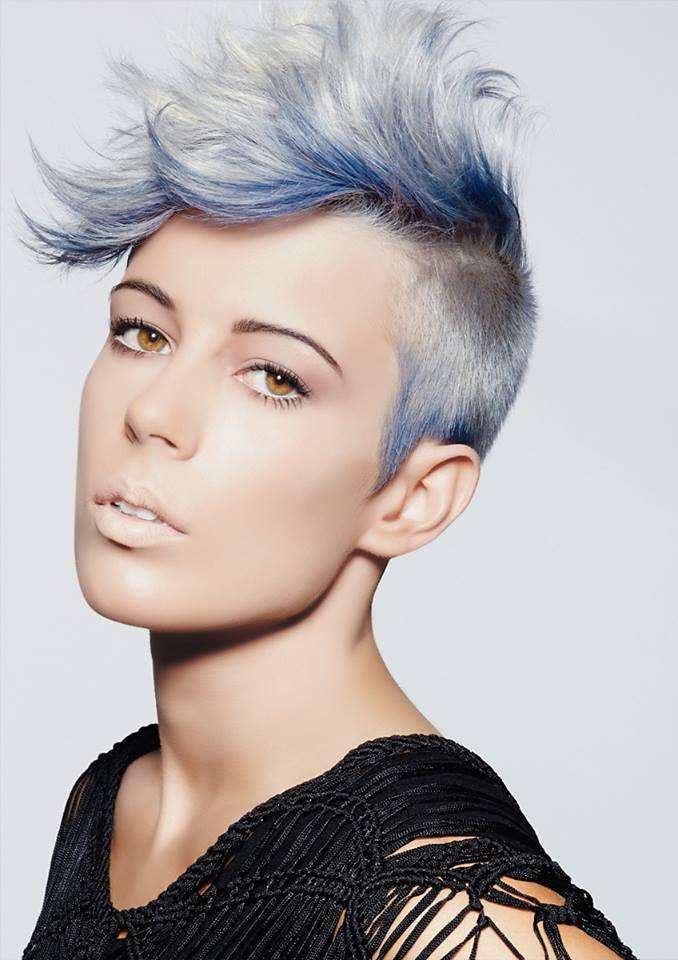 Short, pixie haiirstyle with trimmed sides and blue highlights