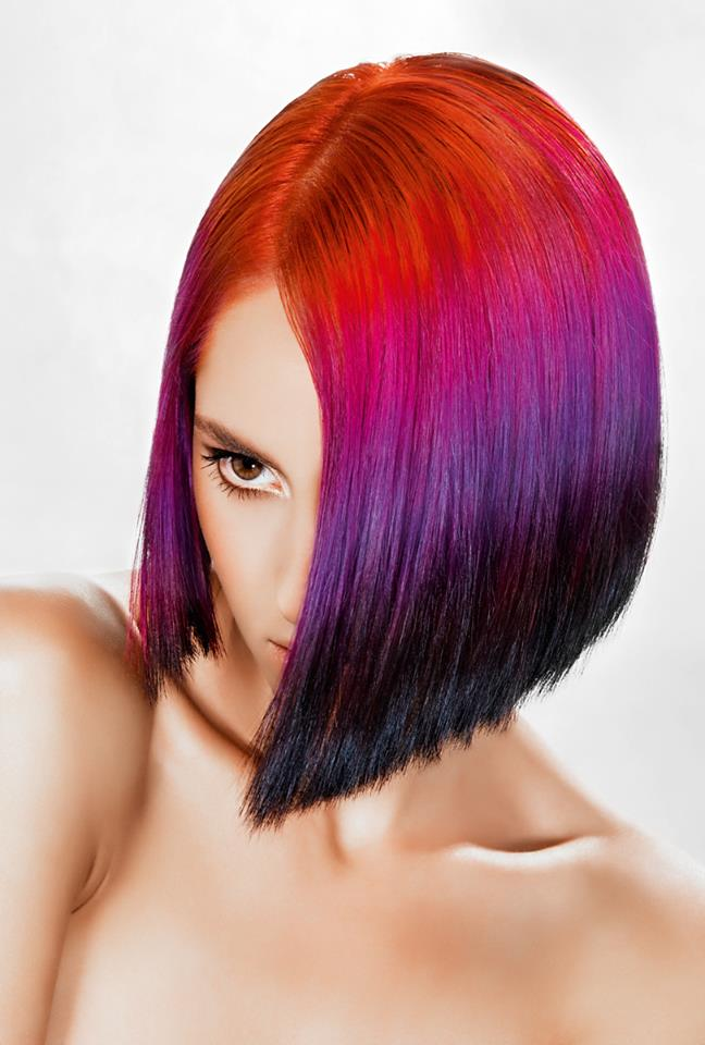 Medium-length colourful hairstyle with red, violet and black hair