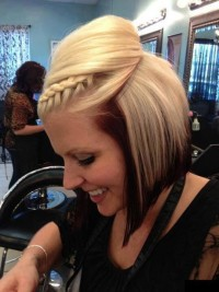 Medium-length updo with crown braid and black layers