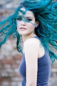 Long, sea-green, curly hairstyle