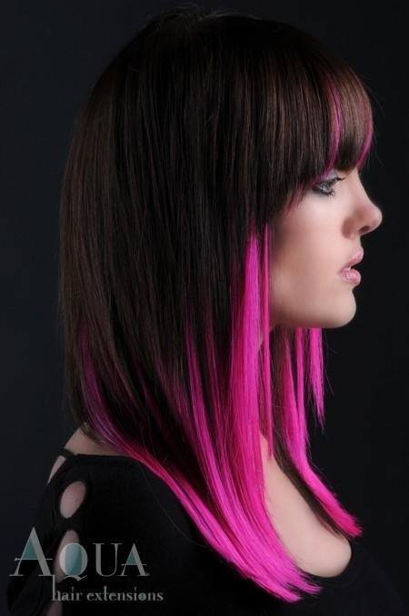 Long, black hair with fuscia pink highlights