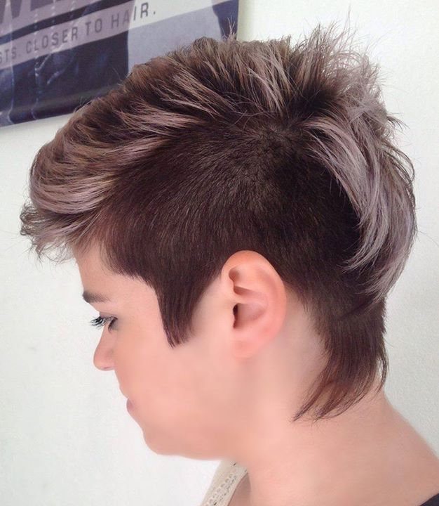 Short, pixie haircut with shaved side and coloured mohawk