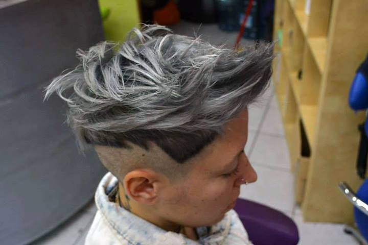 Short, pixie look with messy and choppy top, and shaved sides