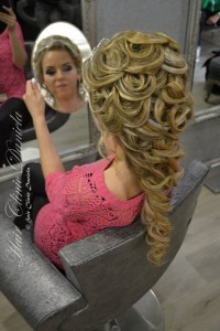 Long, blonde hairstyle with braids and curls