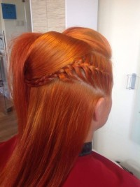 Long, red hairstyle with side braids