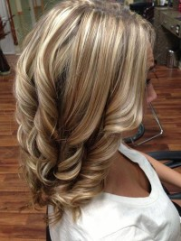 Medium, layered, blonde hair with perfect curls