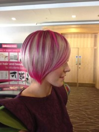 Short, pixie hairstyle with pink and blonde hair