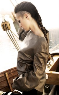 Long, thick, dark braided hairstyle with shaved sides