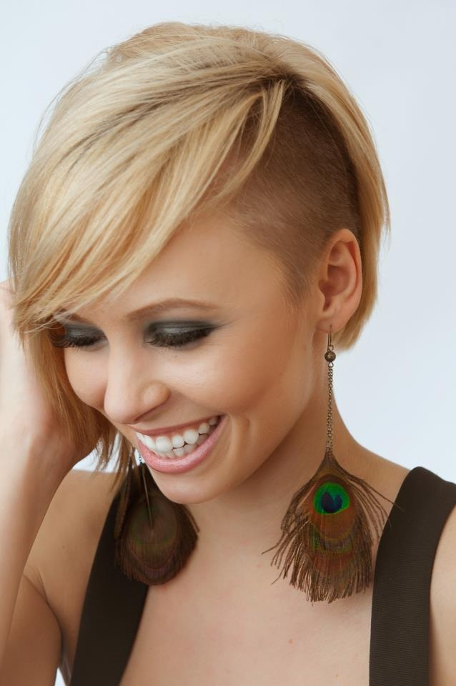 Short, pixie, blonde hairstyle with shaved side and longer bangs