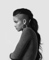 Long, dark hairstyle with shaved sides