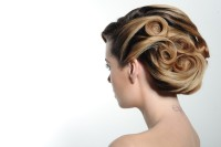 Blond updo for wedding with waves and locks