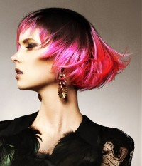 Short, colourful, two-toned hairstyle with pink endings,