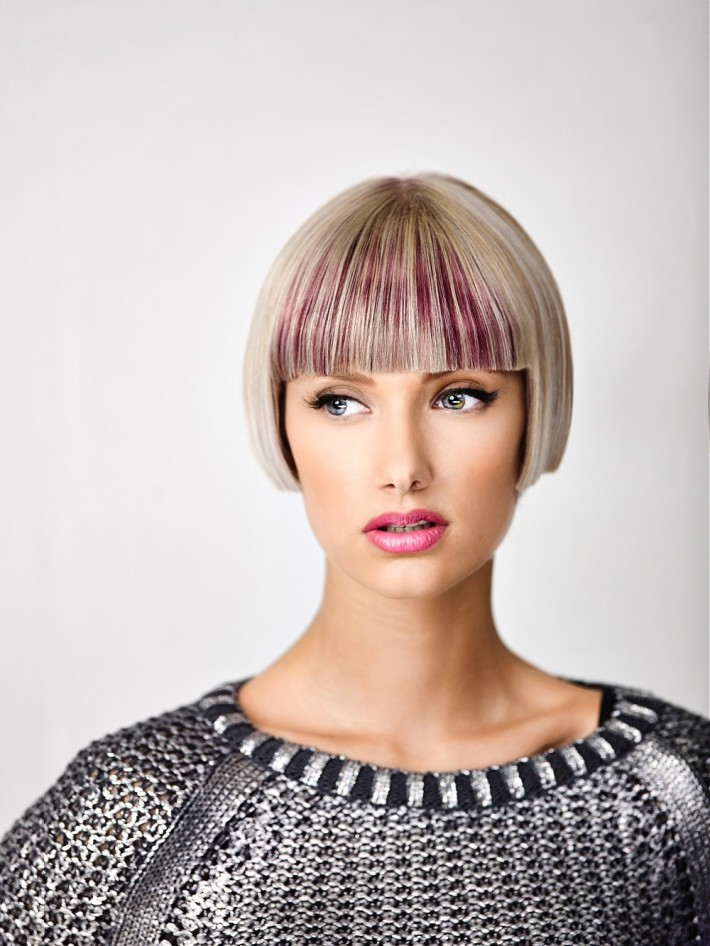 Bowl cut blonde hairstyle with violet streaks