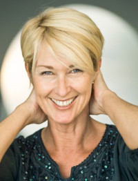 Short, blonde haircut with parted bangs for older women