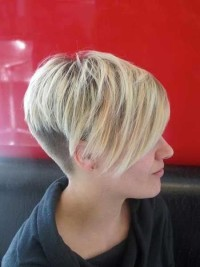 Short, pixie, blonde haircut with shaved back and side-swept bangs