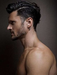 Short hairstyle for men with shaved sides and swept back bangs