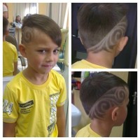 Short blond haircut for boys with side design and longer fringe