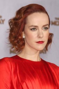 Medium, curly hairstyle with swept back fringe, bangs