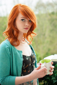 Natural, curly, ginger hairstyle with curls and side-swept bangs