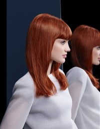 Long, auburn hairstyle with blunt fringe