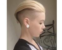 Short, pixie, blond hairstyle with shaved sides and swept back fringe