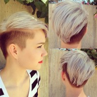 Short, blond hairstyle for pixie girls with darker, shaved sides and comber over hair
