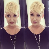 Short, pixie hairstyle with shaved sides and comb over bangs