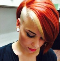 Short hairstyle for red haired women with blond layers and shaved side
