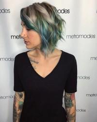 Medium-length haircut with curls and colourfyl highlights
