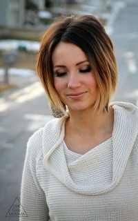Short, pixie hairstyle with parted bangs and light endings