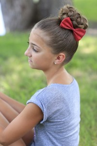 Cute updo with braided top and red bow