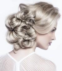 Elegant updo with curly streaks of hair