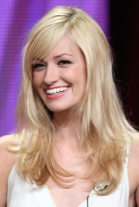 Long, blonde hairstyle with side-swept bangs
