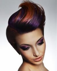Short, pixie hairstyle with wavy, colourful fringe