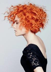 Medium-length, curly, ginger hair