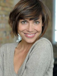 Short, brown hairstyle with side-swept fringe