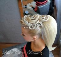 Fancy updo with stylised streaks of hair