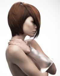 Medium-length brown haircut with longer fringe
