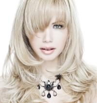 Long, layered, blond hair with longer bangs