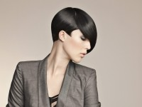 Short, pixie hairstyle with longer bangs