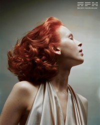 Medium-length, curly, red hairstyle