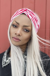 Long, simple, blonde hairstyle with red-white headband