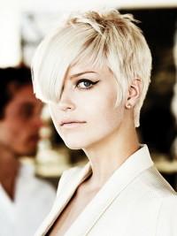 Short, choppy, blonde haircut with bangs