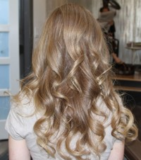 Long, curly, blonde hairstyle