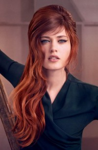 Long, wavy, red hairstyle