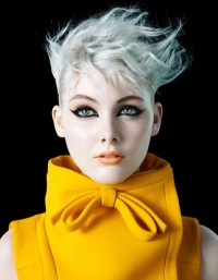 Short, pixie, platinum haircut with wavy, messy fringe