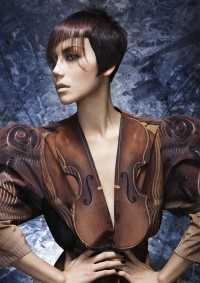 Short, pixie, black hairstyle with wispy, violet bangs